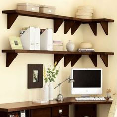 i see this as doable by simply raising the main shelf.  put the computer on the short wall next to the window. use the long wall as a writing surface. mount shelves above for pretty storage. put filing cabinets and/or drawers below. could be good for the budget, too.