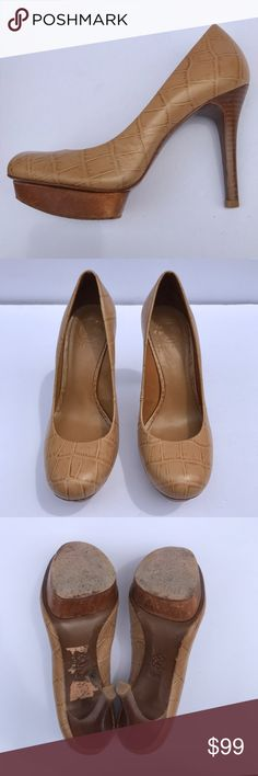 {tory burch} Isabella tan embossed heels Gorgeous embossed crocodile pattern on these tan heels! Wooden platform shoes. Wear on the soles and a little bit elsewhere, as shown in photos, but otherwise these shoes are in great condition. Stylish leather shoes for the office - versatile enough for a night out. Tory Burch Shoes Heels