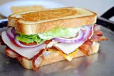 BLT Club Sandwich - bacon, lettuce, tomato, turkey, red onion and cheese