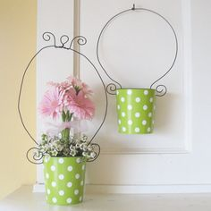 Wrap tin can with decorative paper...use cropadile to punch holes in can for wire or ribbon