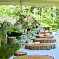 Its been a while since I shared a wedding photo! Our wedding party table at our wedding. Justin cut all of the wood chargers with a chainsaw and then we polyurethaned them. The coasters a s napkin rings were also made this way. We created our own terrariums and did our on flowers as well. The table had a moss runner along the front which the candles and centerpieces sat on.  This was so much fun to decorate!
