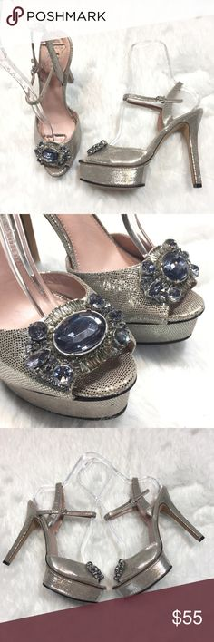 """NWOB Vince Camuto VC Lolita Jeweled platform heels Stunning pair of new without box Vince Camuto peep toe platform stiletto heels with gorgeous Beaded and Jeweled detail at toes. The color is a metallic taupe. 5"""" heel with a 1"""" platform. I ship within 24 hours of purchase. Thank you for looking at my listing! Reasonable offers considered. Vince Camuto Shoes Platforms"""