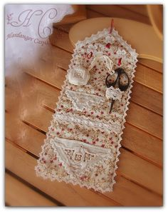 Hardanger needlecase with pockets and fastenings