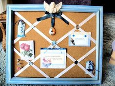 French bulletin board made from an old frame, ribbon, decorated thumbtacks, and cork board.