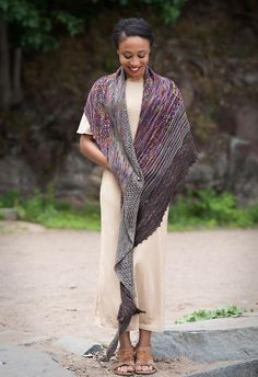 """Washed out is a stunning asymmetrical triangle shawl with faded stripes and lace. Designer: J O J I Finished measurements: 120"""" x 27""""Recommended needles: US6 (4.0 mm) circular, 32"""" cord Included in your kit is 3 skeins in the colourways Confetti, Black Pearl & Black Mousse from our Hummingbird inspired series in the following yarn types: YARN TYPESSerenity 20: 70/20/10 sw superfine merino/cashmere/nylon 