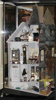 I so want to do this!!!!!!! Haunted doll House. 365 from halloween 2013 to make this for next year