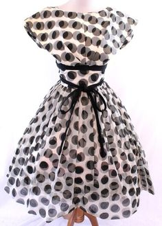 Vintage black and white polka dots- It kind of plays with your eyes.