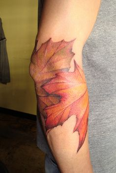 Another autumn leaves tattoo... I don't like the placement but I love the style.