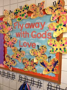 """Spring time bulletin board. Can also be End of year with """"Fly into summer with God's love"""". The Children can cut the butterfly shapes. We asked the children to apply paint (drops or cotton balls) only on one side. Then fold in half.   Open to see the magic"""