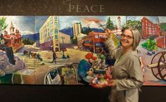 Trish Harding- The Bellingham,WA-based artist and art teacher with one of her murals of downtown Bellingham.