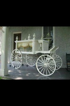 Horse drawn hearse of yester year.