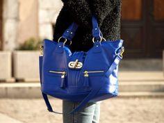 I need a royal blue handbag. Any idea who the designer is?