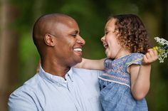 Fun family portrait of a father and daugther