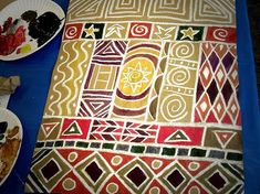 used white oil pastels and acrylic paint to create African patterns on brown craft paper.