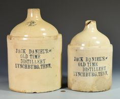 """1st item: Jack Daniels 2 Gallon advertising stoneware whiskey jug with Bristol glaze and stenciled in cobalt on the body """"JACK DANIEL'S, OLD TIME DISTILLERY,  LYNCHBURG, TENN."""" with  """"2"""" on the upper neck denoting gallon capacity. 12 3/4"""" H. Circa 1870 -1875. 2nd item: Jack Daniels 1 Gallon advertising stoneware whiskey jug with Bristol glaze and stenciled in cobalt on the body """"JACK DANIEL'S, OLD TIME DISTILLERY,  LYNCHBURG, TENN."""" 10 1/2"""" H. Circa 1870 -1875. (Additional high-resolution…"""