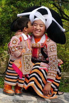 Mother and child ... Long Horn Miao Minority. China