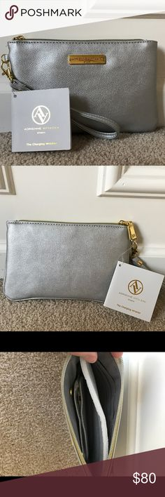 Adrienne Vittadini Charging Wristlet • New With Tags   •Silver Charging Wristlet Purse •Still has padding inside •No Stains or Rips Adrienne Vittadini Bags Clutches & Wristlets