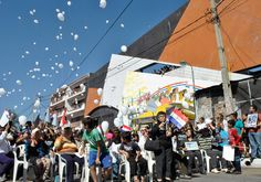 Survivors and relatives of those who died at the Ycuá Bolaños fire released 409 balloons on Aug. 1 to commemorate the eighth anniversary of the tragedy that killed 409, wounded 500 and caused six to go missing. (Marta Escurra for Infosurhoy.com)