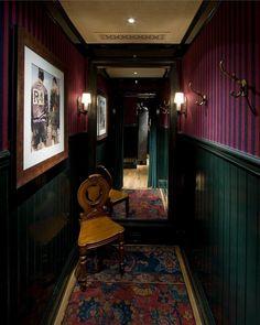 Dark hallway inspiration with sconces - Rugby Ralph Lauren
