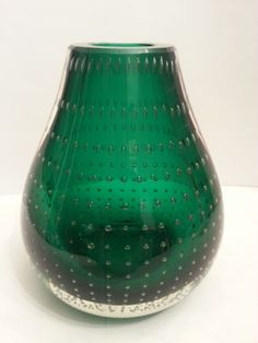 Sold Jan. 2014 for $37/16.45.     Carl Erickson Cased Control Bubble Green Bookend Vase