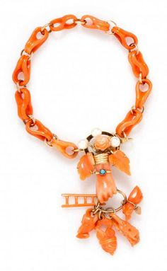 A Victorian Rose Gold, Carved Coral and Pearl Bracelet, consisting of carved fluted orange coral links joined with circular gold links to the center gold clasp accented with three pearls (origin not tested), three carved leaf and blossom motif coral sections and a carved coral clutched hand grasping a circular ring suspending five carved coral elements including a ladder, a mouse, a dog, and two decorative elements.
