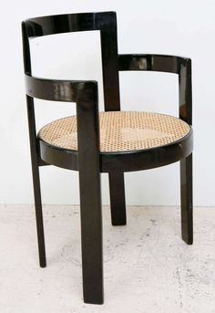 Set of 6 Black Lacquer and Cane Thonet Chairs   From a unique collection of antique and modern armchairs at https://www.1stdibs.com/furniture/seating/armchairs/