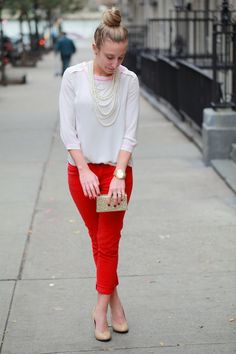 White blouse, red pants, nude pumps, and pearls
