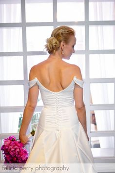 Aqua ~ White satin wedding gown with corseted back, drop shoulder straps, and full cascading train.  Dress is also shown bustled.