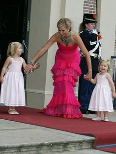 Crown Princess Maxima of the Netherlands latest photos - holds on to her little princesses.