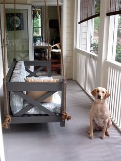 A friend's husband made this for their porch. I've been pining for a swinging bed like this!