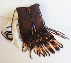 TRIBAL GODDESS deerskin leather Cross Shoulder purse with Copper Jingle cones, Deer antler, Antique Russian Blue trade beads