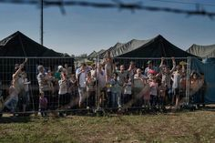 A group of migrants wait at a makeshift detention camp for Hungarian authorities in Roszke, Hungary, to register their arrival in the European Union. Aug.  29, 2015.