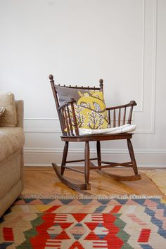 Would love a wooden rocker and that rug!!  Lena Corwin's home on Design*Sponge