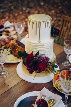 Gold drip wedding cake with white ruffle detail and jewel toned flowers | Kristie Carrick Photography