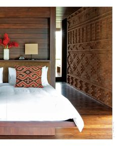 Rich colours contrasted with a white bedspread make for a stylish touch #tribalthreads #wooden #thehomeaus