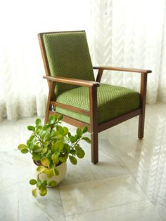 Single armchair - reupholstered in green polka dots