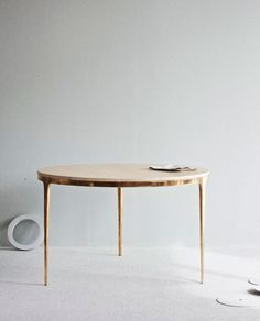 Daniel Barbera marble table with bronze legs. It's sleek, androgynous and the most beautiful 6-seater table I have seen. seriously.