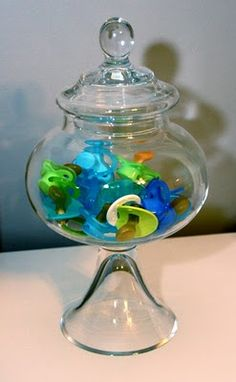 Baby shower gift idea: Apothecary jar filled with pacifiers. Never lose a pacifier again!