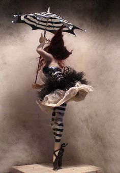 I love this costume. I think it does have an essence of doll about it and it could work really well with my idea.
