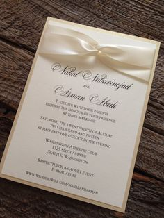 A classic elegant wedding invitation using an infinity loop with satin ivory ribbon. This classy 5x7 invitation comes with a metallic linen champagne backer. Top layer of invitation is printed on Ivory linen cover stock. All fonts, color and ribbon color can be altered to fit your style and wedding AT NO ADDITIONAL CHARGE! Invitation Pricing: 25-49 - $2.90 ea 50-99 - $2.70 ea 100-149 $2.50 ea 150-199 - $2.40 ea 200-249 - $2.30 ea 250+ - $2.20 ea  Matching RSVPs and any addition insert cards…