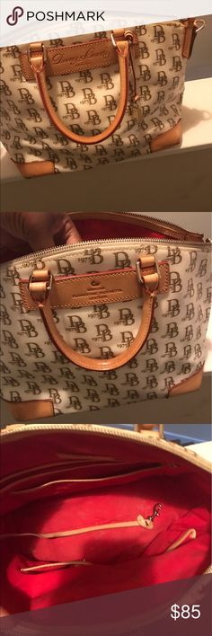 Dooney & Bourke purse Authentic Dooney & Bourke handbag. This bag comes from a smoke free home, it is in good used condition there are a few pin marks on the bottom corners of the purse as pictured above. Dooney & Bourke Bags Satchels