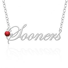 """Oklahoma Sooners Script Necklace with Color Crystal Accent  Our collegiate cutout script necklace is accented with a sterling silver and crystal ball charm representing the schools color. The way the school colored crystal accents the sterling silver necklace is just enough to make it """"too cute to resist"""". This necklace is another great way to show your spirit in style!  #oklahoma #university #jewelry #sooners #college #boomer #necklace #script #crystal #red"""