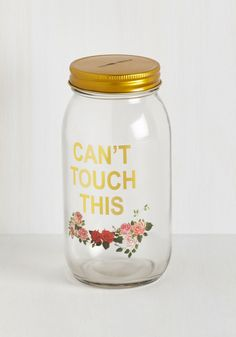 Your rainy day fund looks super fab inside of this glass savings jar! No 'hammer time' needed with this quirky coin bank, for its golden slotted lid screws off with ease. Printed with roses and a reminder to conserve your currency, this container holds your finances with a fun finesse.