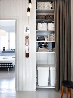 this is the perfect laundry closet. or bathroom closet. some room for hampers on the bottom, towels above, and storage all the way up to the top. i think a pocket door would be better so the dogs won't get in there though.
