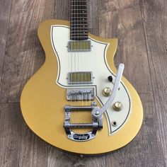 Up for sale is a custom Titan Kr1 loaded with gold foil pickups, mastery bridge and a bigsby.