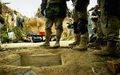 """American soldiers in the Infantry Division stand over the opening of the """"spider hole"""" where Saddam Hussein was captured December 2003 in Ad Dawr, Iraq. Iraq's notorious dictator was captured in a raid at the compound on December Hubert Humphrey, 4th Infantry Division, Saddam Hussein, Tactical Life, Weapon Of Mass Destruction, Robert Kennedy, War Image, Iraq War, American Spirit"""