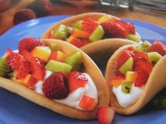 Sugar Cookie Tacos ~ 1 pkg 18oz refrigerated sugar cookie dough,   2 T cinnamon, 1 C whipping cream,   1/4 C sugar, 2 C cut-up fruit