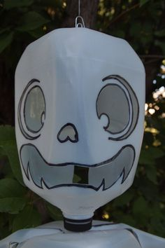 I LOVE IT - especially with Halloween coming up. Skeleton recycled milk jug halloween decoration by ZiggysHollow, $15.00