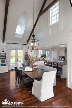 Huge lantern hanging over the dining table is what draws my here, in a room filled with architectural delights. - Patrick Ahearn, architect. - Located on Martha's Vineyard, the HGTV Dream Home 2015 is a Cape Cod, cottage style architecture.