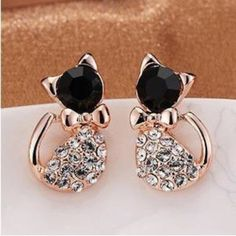 ✨Back in stock!✨ Lovely rhinestone kitten earrings Super cute and classy cat stud earrings. Body fully covered with gorgeous Austrian rhinestone. Gold tone. New in package. When ready to purchase please comment and I will create a separate listing for you. Jewelry Earrings